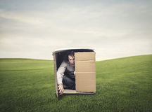 Man in a box. Man closed in a box in the valley Royalty Free Stock Photography
