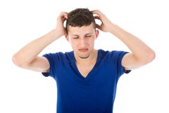 Man with closed eyes and hands at his head. Isolated over white Stock Photo