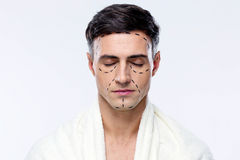 Man with closed eyes. And marked with lines for plastic surgery Royalty Free Stock Photos