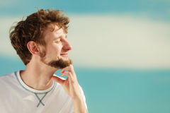Man with closed eyes relaxing breathing fresh air. Stock Photo