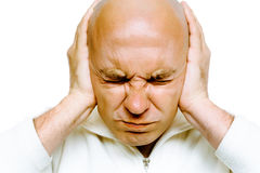 Man closed his eyes and covered his ears with his hands. Studio. Stock Image