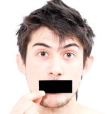 Man closed his mouth a piece of paper Royalty Free Stock Photos