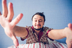 Man closed one eye and stretches Stock Photo