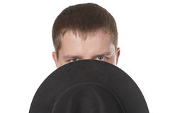 The man closes the bottom part of the face a hat. Royalty Free Stock Photos