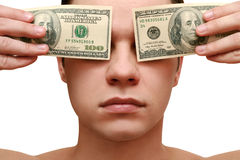 Man closes his eyes with money Stock Photo