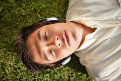 Man closes his eyes while using headphones Stock Photography