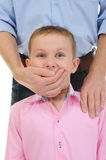 Man closes a mouth a hand to the boy Stock Photo