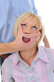 Man closes a mouth a hand to the woman Royalty Free Stock Images