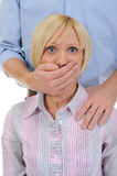 Man closes a mouth a hand to the woman Royalty Free Stock Photos