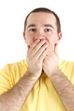 Man closes the mouth with her hands Royalty Free Stock Photography