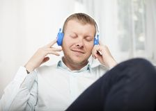 Man closing his eyes as he listens to music royalty free stock images