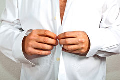 Man closing his shirt Royalty Free Stock Photos
