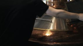 Man closing a lid of a beer cask. Close up of a hand of a brewery worker closing a lid of a beer cask at a craft beer brewery. Handheld real time close up shot stock video