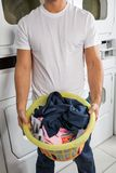 Man With Clothes Basket In Laundry Royalty Free Stock Image