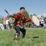 Man in clothes indigenous people of Kamchatka dancing with a tambourine Stock Images