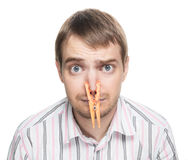 Man with clothespin on his nose. Royalty Free Stock Photos