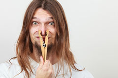 Man with clothespin on nose Stock Image