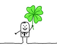 Man with clover Stock Photos