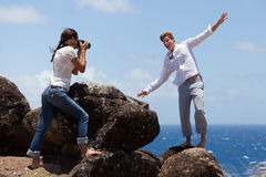 Man Clowns Around While Woman Takes His Photo Royalty Free Stock Photography