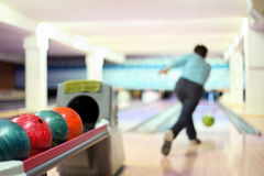 Man in club for bowling throw ball. Man in blue in club for bowling throw ball royalty free stock photo