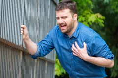 Man feeling chest pain and heart attack symptom royalty free stock images