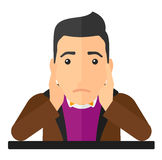 Man clutching his head in desperate. A disappointed young man sitting at the table clutching his head vector flat design illustration isolated on white Stock Images