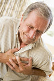 Man Clutching His Heart stock image