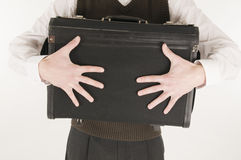 Man clutching suitcase Stock Images