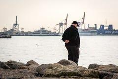 Man on the coast of Bosphorus royalty free stock photography