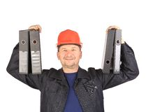 Man in coat holding folders. Royalty Free Stock Photography