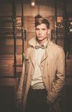 Man in coat inside vintage train Stock Photography