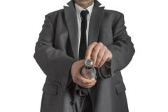 Man in Coat opening Champagne Bottle Royalty Free Stock Photo