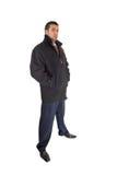 Man in coat standing. Stock Photos