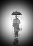 Man in coat with umbrella Stock Photo