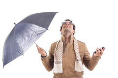 Man in the coat with an umbrella in studio Royalty Free Stock Image