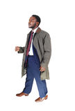 Man in coat walking. Stock Photography
