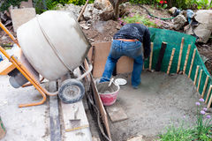 Man Coating With Cement An Artificial Pond Stock Photography