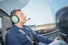Man in cockpit aircraft. Man in cockpit of aircraft royalty free stock photos