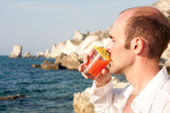 Man with cocktail Stock Photography