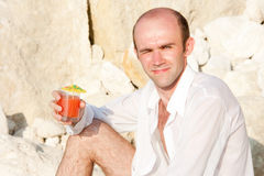 Man with cocktail Stock Images