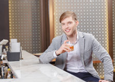 Man with a cocktail in the bar Stock Photography