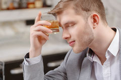 Man with a cocktail in the bar Stock Photo