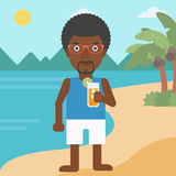 Man with cocktail on the beach. Royalty Free Stock Photos