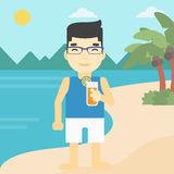 Man with cocktail on the beach. Royalty Free Stock Photo