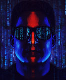 Man coder portrait. Young cool man program coder in sunglasses portrait. Contrast dramatic blue and red colors and code symbols stock image