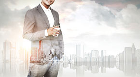 Man with coffee and a city, toned Stock Photo