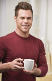 Man with Coffee Cup Stock Image