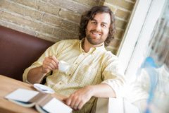 Man With Coffee Cup And Book In Cafe Stock Photos