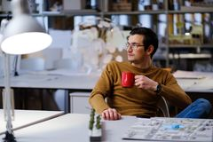 Man with coffee in design and engineering architecture office. Man working in design and engineering architecture office Stock Photos