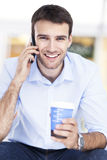 Man with coffee and mobile phone Royalty Free Stock Photo